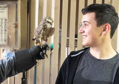Young Reporter Alex Koss meets a burrowing owl at Liberty Wildlife, a rehabilitation center.