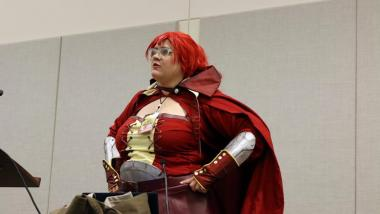 Kimberly Speer, 28, dressed as Amber from Fire Emblem, leads the conversation to a crowd of cosplayers at Phoenix Comicon on how to succeed at creating costumes regardless of weight or size. Previously bullied for her costumes, she now preaches confidence and community to concerned players. (Photo by Devin Conley/Cronkite News)