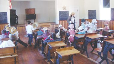Teacher and students go in costume, wearing clothing of the time period.