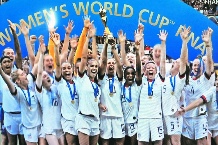 U.S. Women's Team players show off their World Cup trophy!
