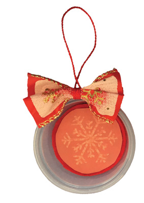 Round holiday ornaments made out of plastic containers